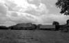 © Roger Choplain, Roland Maston, Région Auvergne - Inventaire général du Patrimoine culturel, ADAGP - Ferme : grange étable et porcherie, façades antérieures Nord-Est.